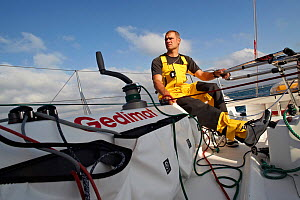 """Skipper Thierry Chabagny helming on board """"Gedimat"""" ahead of La Solitaire du Figaro, Concarneau, France, July 2011. All non-editorial uses must be cleared individually.  -  Benoit Stichelbaut"""