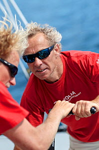 """Skipper Roland Jourdain grinding on board MOD70 trimaran """"Veolia Environnement"""", Concarneau, Brittany, France, June 2011. All non-editorial uses must be cleared individually. - Benoit Stichelbaut"""
