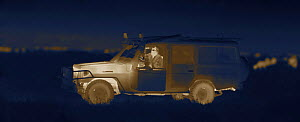 Martin Dohrn in night filming vehicle, on location for National Geographic Nightstalkers, Topi Plain, Masai Mara, Kenya. Image taken using a thermal camera, without artificial light. *THIS IMAGE CAN O...  -  Martin Dohrn