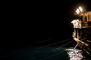 Purse seiner with thousands of watts of lights which remain on for 3 straight hours to attract fish. These vessels are very effective at targetting schools of fish that aggregate near the surface of t... - Jurgen Freund