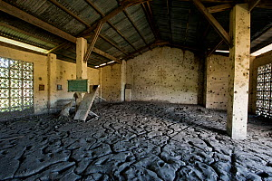 One metre of mud has washed into this now abandoned local church in Barangay Victoria. The mud has cracked in the dry summer heat, turning to fine dust that has permeated everything. Mindoro, Philippi...  -  Juergen Freund