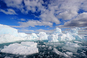 Melting ice under expansive clouds. Floe Edge, Arctic Bay, Baffin Island, Nunavut, Canada, April 2009.  -  Eric Baccega