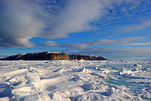 Icepack, cliffs and melting icepack in spring. Arctic Bay, Baffin Island, Nunavut, Canada, June. - Eric Baccega