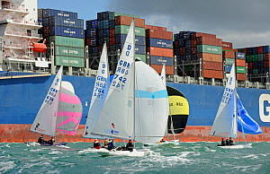 Dragons racing close to container ship during day two of Aberdeen Asset Management Cowes Week in Cowes, Isle of Wight, England, August 2011.  -  Rick Tomlinson