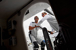 Armel Le Cleac'h and Christopher Pratt grinding on board monohull ^Banque Populaire^ during training ahead of Transat Jacques Vabre 2011. Lorient, Brittany, France, July 2011. All non-editorial uses m... - Benoit Stichelbaut