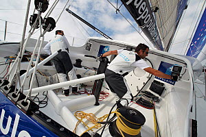 """Armel Le Cleac'h and Christopher Pratt in cockpit on board monohull """"Banque Populaire"""" during training ahead of Transat Jacques Vabre 2011. Lorient, Brittany, France, July 2011. All non-editorial uses...  -  Benoit Stichelbaut"""