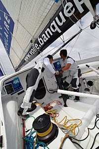 """Armel Le Cleac'h and Christopher Pratt grinding on board monohull """"Banque Populaire"""" during training ahead of Transat Jacques Vabre 2011. Lorient, Brittany, France, July 2011. All non-editorial uses m... - Benoit Stichelbaut"""