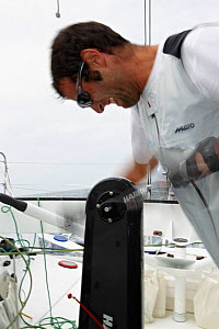 """Armel Le Cleac'h grinding on board monohull """"Banque Populaire"""" during training ahead of Transat Jacques Vabre 2011. Lorient, Brittany, France, July 2011. All non-editorial uses must be cleared individ... - Benoit Stichelbaut"""