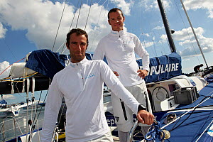 Armel Le Cleac'h and Christopher Pratt on board monohull ^Banque Populaire^ during training ahead of Transat Jacques Vabre 2011. Lorient, Brittany, France, July 2011. All non-editorial uses must be cl... - Benoit Stichelbaut