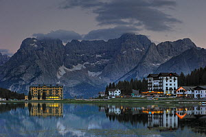 The mountain range Gruppo del Sorapis and hotels at night along lake Lago di Misurina. Auronzo di Cadore, Dolomites, Italy, July 2010.  -  Philippe Clement