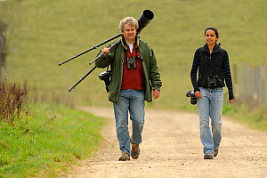 Photographer David Tipling and Young Champion Shabana Shaffick-Richardson carrying photo equipment at Rutland Water, on location for 2020 Vision, Rutland, UK, April 2011. Model released - Terry Whittaker / 2020VISION