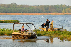 Reserve Manager Tim Appleton, Osprey Project Manager Tim Mackrill, Field Officer John Wright and Assistant Warden Lloyd Park check nesting islands and rafts at the Anglian Birdwatching Centre, using a...  -  Terry Whittaker / 2020VISION