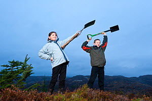 Children from Lochinver primary school planting trees on moorland at Culag Wood, Sutherland, Highlands, Scotland, UK, January 2011. Photographer quote: 'Getting out of the classroom, even on a cold, c... - Niall Benvie / 2020VISION