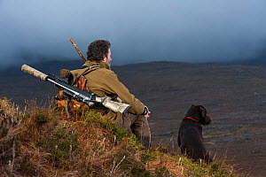 Don o�Driscoll, JMT, looking out over the moorland, with dog, Quinag, Sutherland, Highland, Scotland, UK, January 2011. 2020VISION Exhibition. 2020VISION Book Plate. - Niall Benvie / 2020VISION