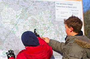 Two boys looking at map of The National Forest, Moira, Derbyshire, UK, November 2010  -  Peter Cairns / 2020VISION