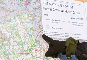 Boy pointing to map of The National Forest, Moira, Derbyshire, UK, November 2010  -  Peter Cairns / 2020VISION