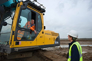Machine operator Alan Deval and RSPB Project manager Dave Hedges. Wetland habitat ecosytem creation for the RSPB by Breheny Civil Engineers at Bowers Marsh RSPB Reserve, Thames Estuary, Essex, UK. Nov...  -  Terry Whittaker / 2020VISION