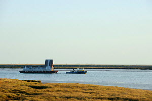 Tug towing house barge along River Roach, Wallasea Island, Essex, UK, February 2011 - Terry Whittaker / 2020VISION