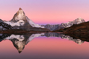 Matterhorn at sunrise in autumn with reflection in the Riffelsee. Zermatt, Valais, Switzerland, Europe, October 2008.  -  Stefan Huwiler