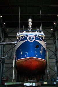Fishing vessel in shiplift facility awaiting repair. Peterhead, Scotland, July 2011.  -  Philip Stephen