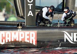 Crew winching on board 'Emirates Team New Zealand' during fleet race on day five of the America's Cup World Series in Plymouth, England, September 2011. All non-editorial uses must be cleared individu... - Chris Schmid