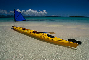Kayak with small sail in translucent water, Solomon Islands, Melanesia, August 2008. - Fred Olivier