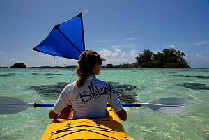 Woman kayaking in the Solomon Islands, Melanesia, August 2008. - Fred Olivier