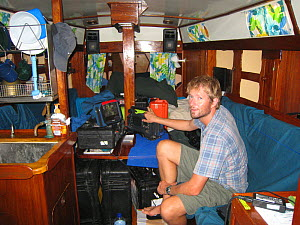 BBC Series South Pacific producer Mark Brownlow on board yacht 'Kuna', Solomon Islands, Melanesia, May 2008. - Fred Olivier