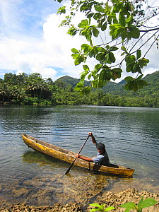 Young boy in canoe, Russel Islands, Solomon Islands, Melanesia, May 2008. - Fred Olivier
