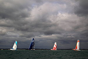 MOD 70 trimarans 'Race for Water', 'Veolia Environnement' and 'Foncia' racing along with 77ft 'Gitana II' during the Krys Match, La Trinite-sur-Mer, Brittany, France, October 2011. All non-editorial u...  -  Benoit Stichelbaut