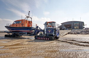 Experimental RNLI lifeboat with launch tractor and trailer undergoing trials. Hoylake Lifeboat Station, Wirral, Merseyside, England, September 2011. ^^^  The Experimental Lifeboat will eventually be... - Graham Brazendale