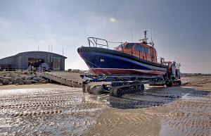 Experimental RNLI lifeboat on trailor waiting to undergo trials. Hoylake Lifeboat Station, Wirral, Merseyside, England, September 2011. ^^^  The Experimental Lifeboat will eventually become the RNLI... - Graham Brazendale