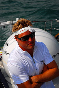 Singlehanded sailor Alex Thomson with head bandaged after waterskiing injury. The Solent, Hampshire, England, August 2006. All non-editorial uses must be cleared individually.  -  Nic Compton
