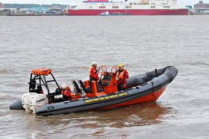 Merseyside Fire and Rescue boat and crew on hand during Powerboat races, River Mersey, Liverpool, England, September 2011. - Norma Brazendale