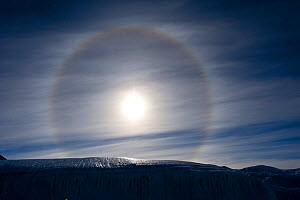 Sun Dog, or Parhelion, caused by refraction of the sun's rays, more commonly seen in Antarctica, above glacier, Dry Valleys, Antarctica, December 2009. Taken on location for the BBC series, Frozen Pla... - Jeff Wilson