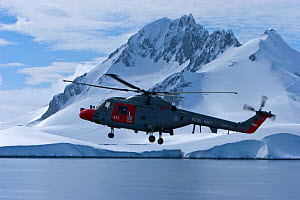 Royal Navy helicopter from HMS Endurance flying over sea and antarctic landscape, November 2008,  Taken on location for the BBC series, Frozen Planet.  -  Jeff Wilson