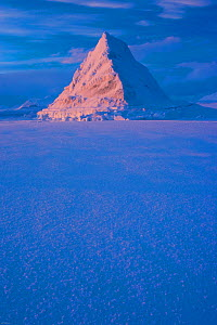 Pyramid of sea ice catching the first rays of the returning sun in the high Arctic, Svalbard, Spitsbergen, Norway, February 2009. Taken on location for the BBC series, Frozen Planet.  -  Jeff Wilson