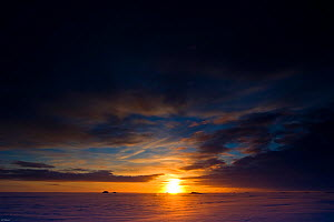 The sun returns for the first time to Svalbard, Norway, in the High Arctic after an absence of six months during the Arctic winter, February 2009. Taken on location for the BBC series, Frozen Planet.  -  Jeff Wilson