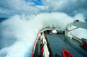 Royal Navy ship, HMS Endurance, crashing through the waves in the south atlantic ocean, Antarctica, November 2009. Taken on location for the BBC series, Frozen Planet. - Jeff Wilson