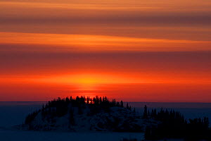 Sunset over Northern Canada landscape, taken on location for BBC Frozen Planet series, 2009  -  Chadden Hunter