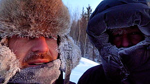 Cameraman Jeff Turner and Producer Chadden Hunter exposed at -40 degrees in Arctic circle in Northern Canada while filming wolves and bison hunting sequence. Taken on location for BBC Frozen Planet se... - Chadden Hunter