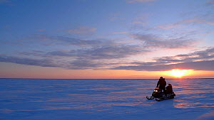 Travelling across Northern Canada on skidoo, Arctic circle, Taken on location for BBC Frozen Planet series, 2009  -  Chadden Hunter