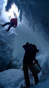 Entering the ice caves of Mount Erebus, Antarctica. Taken on location for BBC Frozen Planet series, 2009  -  Chadden Hunter