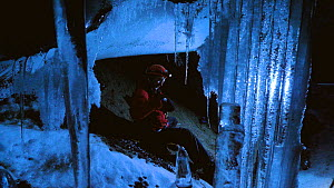 Filming around the extremely delicate ice formations in volcanic ice cave, Mount Erebus, Antarctica. Taken on location for BBC Frozen Planet series, 2009  -  Chadden Hunter