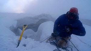 Stormy conditions outside the entrance to ice caves of Mount Erebus, Antarctica. Taken on location for BBC Frozen Planet series, 2009 - Chadden Hunter