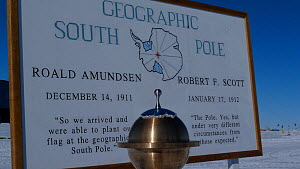 Geographical South Pole marker, Antarctica. Taken on location for BBC Frozen Planet series, 2009  -  Chadden Hunter