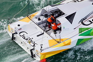 Crew in cockpit of IMOCA open 60 'Pieds Gamesa' at start of Transat Jacques Vabre, Le Havre, France, November 2011. All non-editorial uses must be cleared individually. - Benoit Stichelbaut