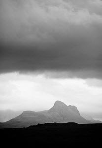 Silhouette of Stac Pollaidh against storm sky, viewed from Tanera More, Coigach and Assynt, Sutherland, Scotland, UK, July 2011  -  Niall Benvie / 2020VISION