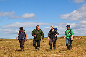 Family on guided walk with RSPB Volunteer, Forsinard Flows reserve, The Flow Country, Caithness, Highland, Scotland, UK, June 2011 - Peter Cairns / 2020VISION