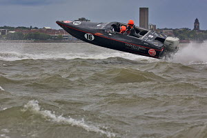 P150 Class boat 'Black Magic' during a race on day one of the P1 Superstock Liverpool Grand Prix of the Sea, River Mersey, England, September 2011. - Graham Brazendale